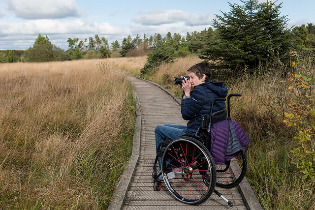 photo of wheelchair user taking photographs