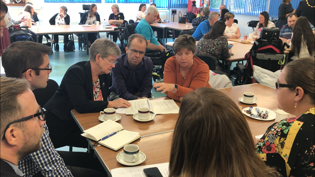 Photo of Jane Hutt speaking to disabled people in Bridgend