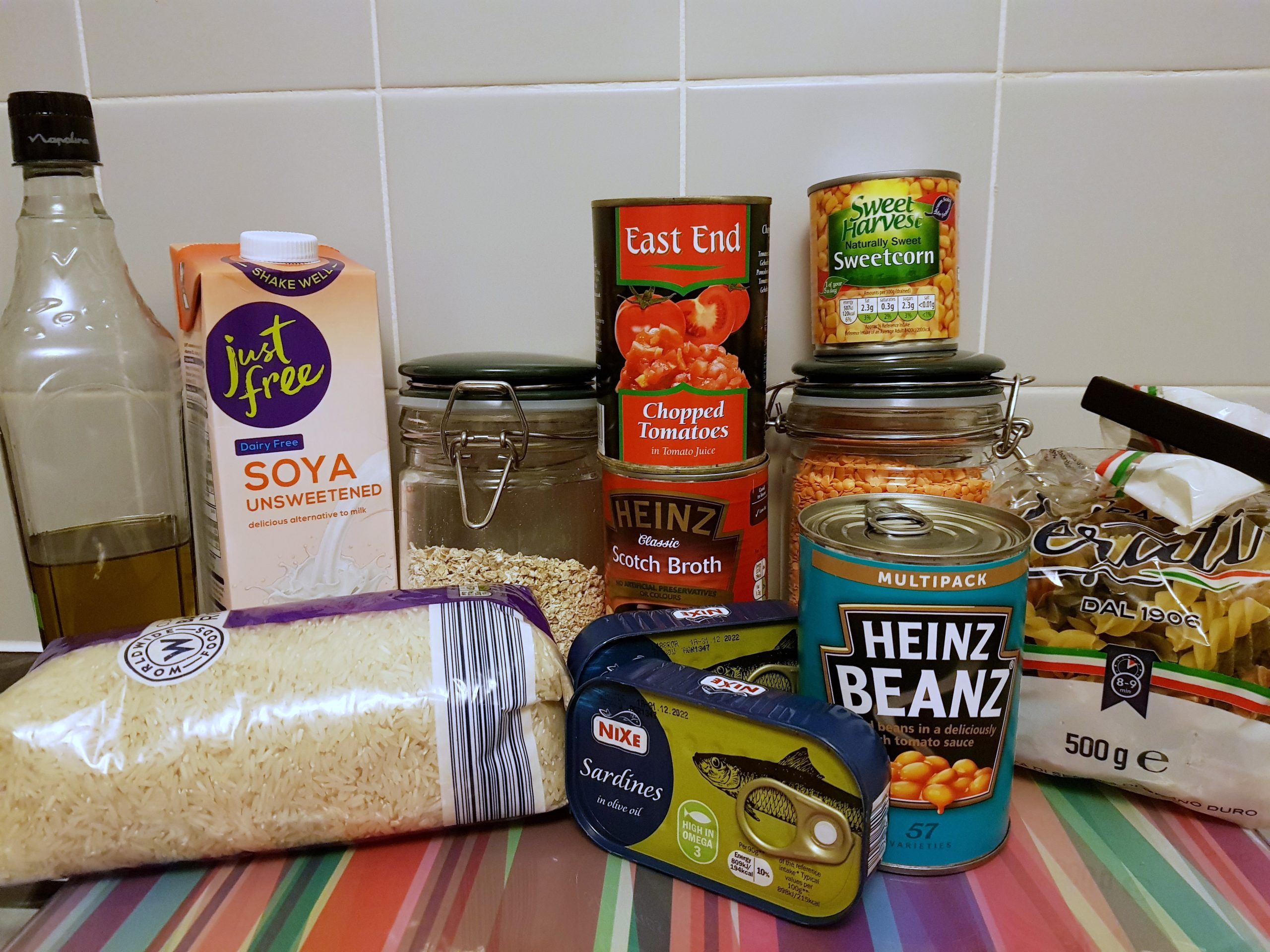 a range of food in cans, jars and packets