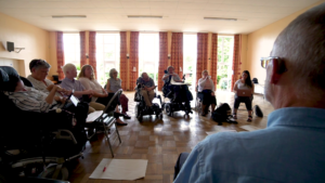 a group of disabled people in discussion in a function room